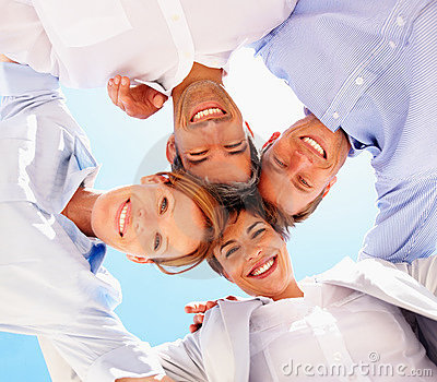 Business people smiling with heads together