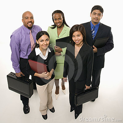 Business people standing with briefcases.