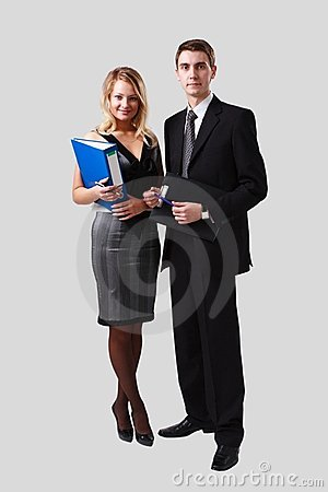 Business people standing on a gray background