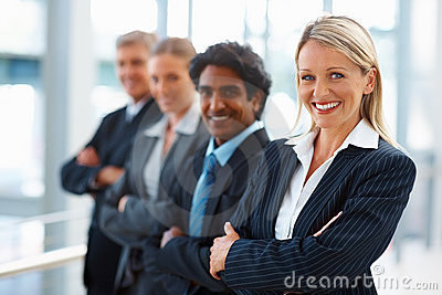 Business people standing with their hands folded