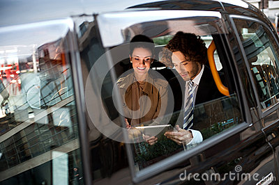 Business people in taxi cab