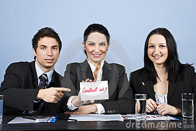 Business people team with contact us message