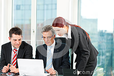 Business people - team meeting in an office