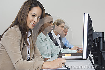 Business People Using Computers In Classroom