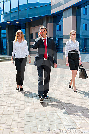 Business people walking i
