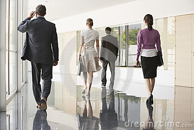 Business People Walking On Marble Flooring