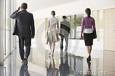 Business People Walking On Marble Flooring