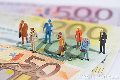 Business people walking on paper money