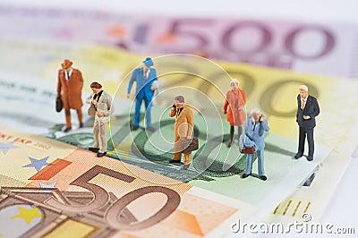Business people walking on paper money