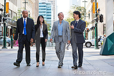 Business people walking together on street