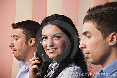Business people with woman  calling by phone