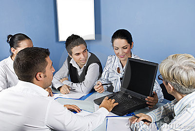 Business people working on laptop at meeting