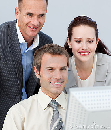 Business people working together with a computer