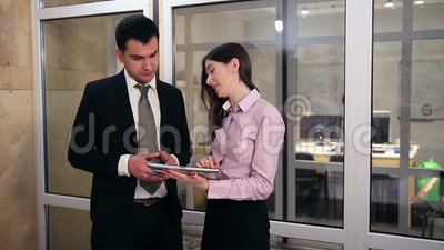 Business people working on touchpad stock video