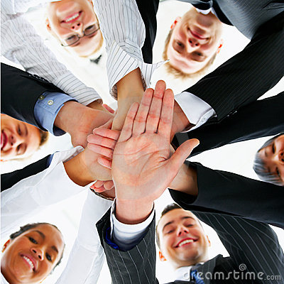 Business peoples hands showing unity
