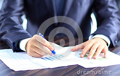 Business person analyzing graphs