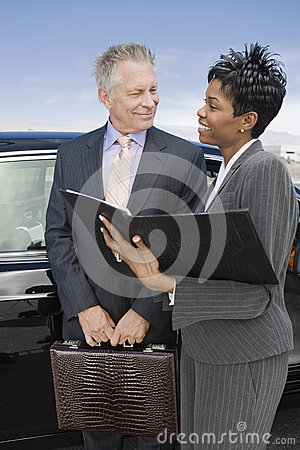 Business Person Discussing Reports At Airfield