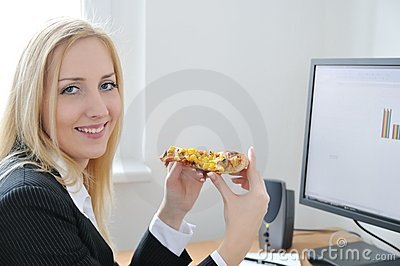 Business person eating at computer