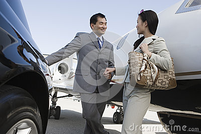 Business Person Holding Hands At Airfield