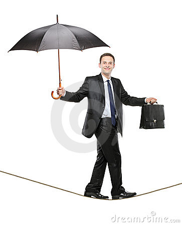 A business person holding an umbrella