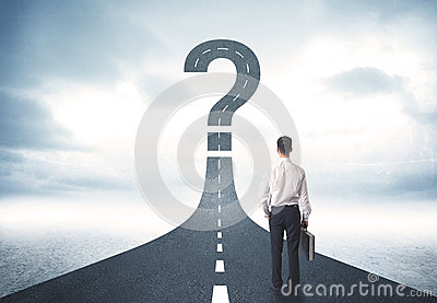 Business person lokking at road with question mark sign Stock Photo