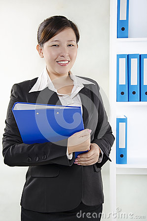 Business person standing and holding a document