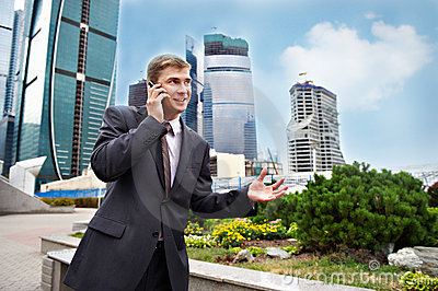 Business positive talks of young man on the phone