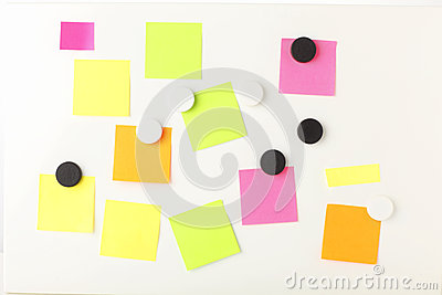 Business  Post It  notes on magnetic board