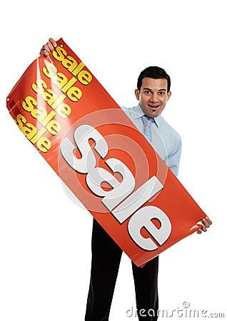 Business or salesman holding Sale Banner