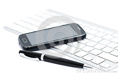 Business smartphone on the keyboard, with pen