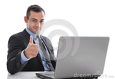 Business: successful man giving thumbs up sitting at desk in fro