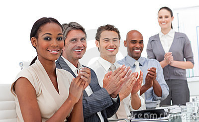 A business team applauding a presentation