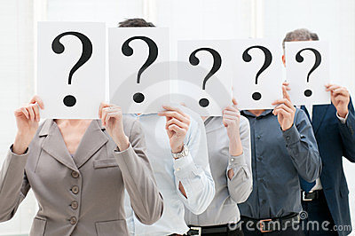Business team behind question marks