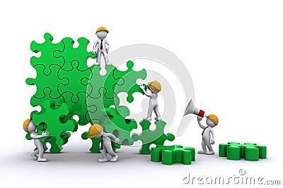 Business team building a puzzle