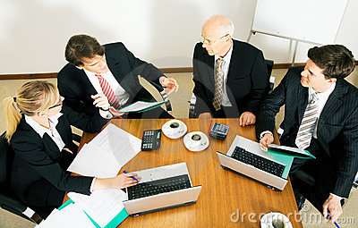 Business Team discussing various proposals