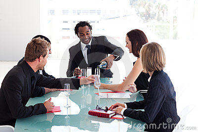 Business team drinking champagne in a meeting