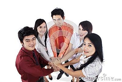 Business team join hands