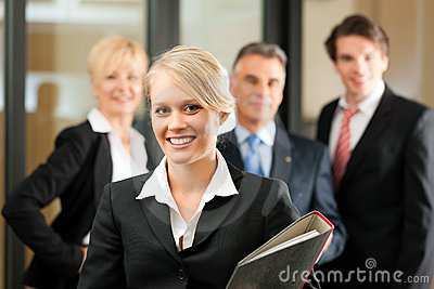 Business Team with leader in office