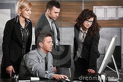 Business team looking at screen