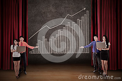 Business team present profit bar chart on stage
