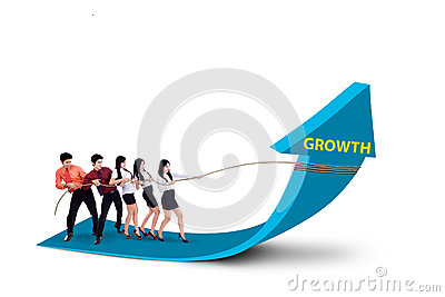 Business team pulling growth arrow sign -