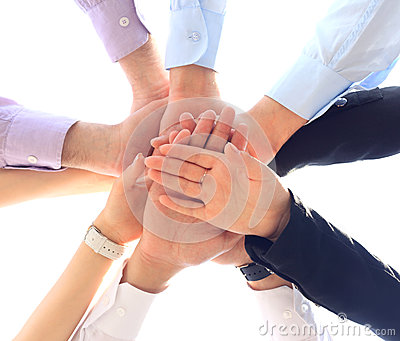 business team putting hands on top of each other