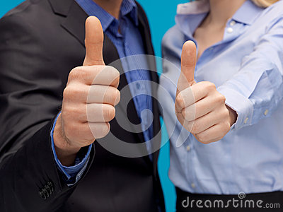 Business team showign thumbs up