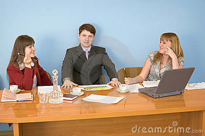 Business team sits at the table