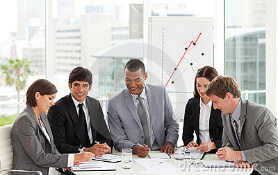 Business team sitting around a conference table