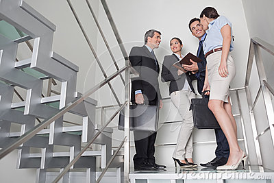 Business team in stairway