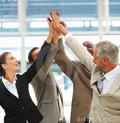 Business team with their hands raised together