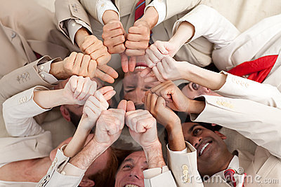 Business team with thumbs up lying in a circle