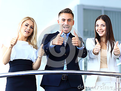 Business team with the thumbs