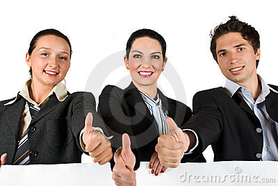 Business team with thumbs up and white sign